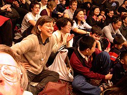 Audience members enjoy a Chinese Puppet Performance.  Photograph by Rachel Cooper.
